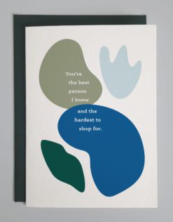 """An abstract blue and green card that reads """"You're the best person I know and the hardest to shop for."""""""