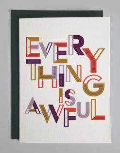 """Outside of card that says in purple, red and golden colorful designed letters, """"Everything is awful."""""""