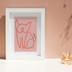 Photo of line drawing of frenchie art print in a frame on a pink background