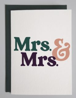 Card that reads Mrs and Mrs in teal, pink and purple