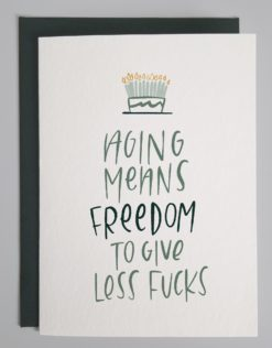 """Card that shows a hand drawn cake and hand lettering that reads """"aging means freedom to give less fucks"""""""