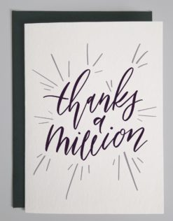 """card that reads """"thanks a million"""" in purple script"""