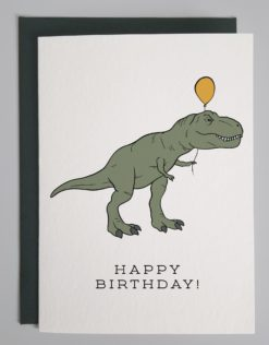 card that shows a t-rex carrying a yellow balloon with text that says happy birthday