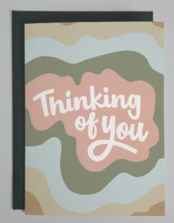 """Card with words """"thinking of you"""" on different colored background"""